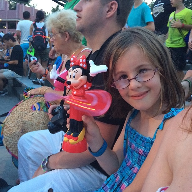 Waiting to see #fantasmic with a new #minniemouse addiction #disney