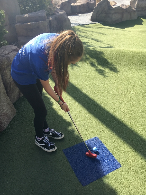 playing crazy golf